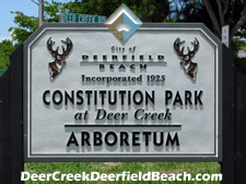Sign along Hillsboro Blvd. marking entrance to the Deerfield Beach-run Constitution Park which offers residents of Deer Creek use of some excellent amenities.